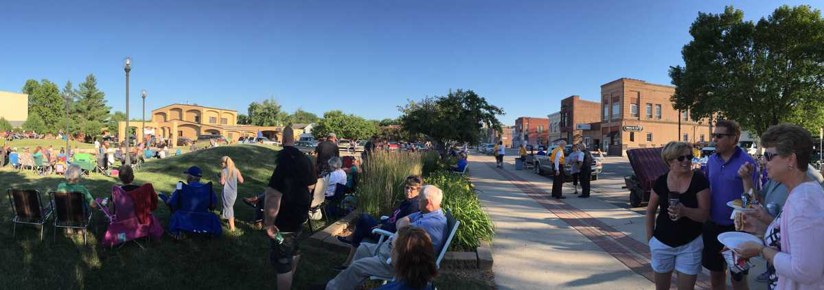Concert-goers talking and enjoying the evening in downtown Webster City, Iowa.