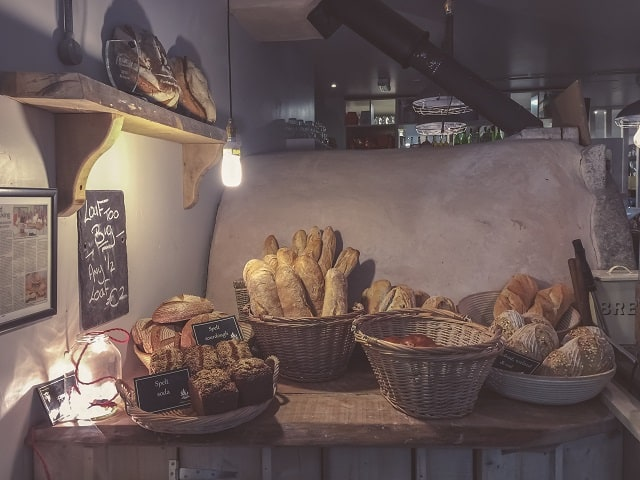 Baskets of bread in a rustic kitchen